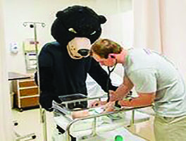 LRU Nursing Student with Baby and Bear